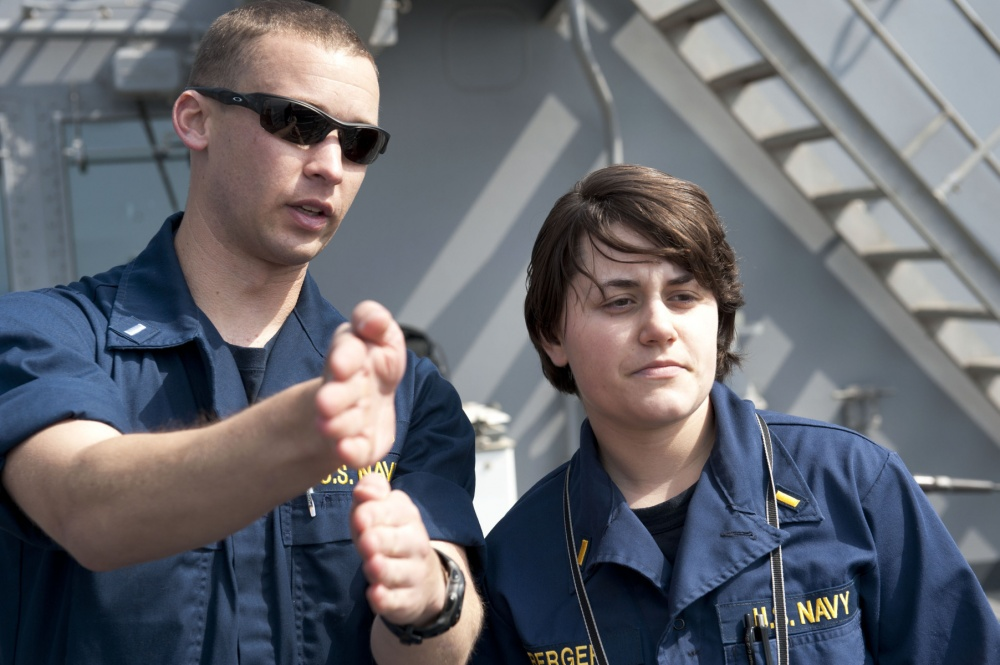 Steph Berger, Williams Class of 2011, at right, aboard the USS Pearl Harbor.