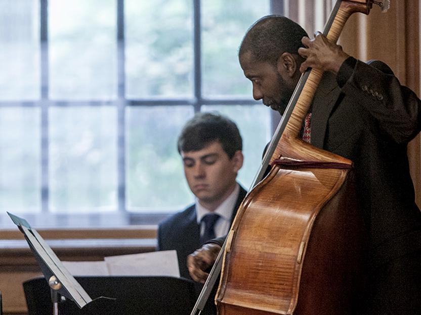 A photo oflecturer Avery Sharpe playing bass.