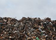 Photograph showing a hill of trash from a dump.