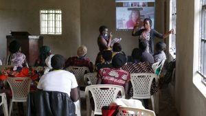 Jackline Odhiambo, Williams Class of 2013, speaks to a group at Nyanam International in the Lake Victoria region of Kenya.