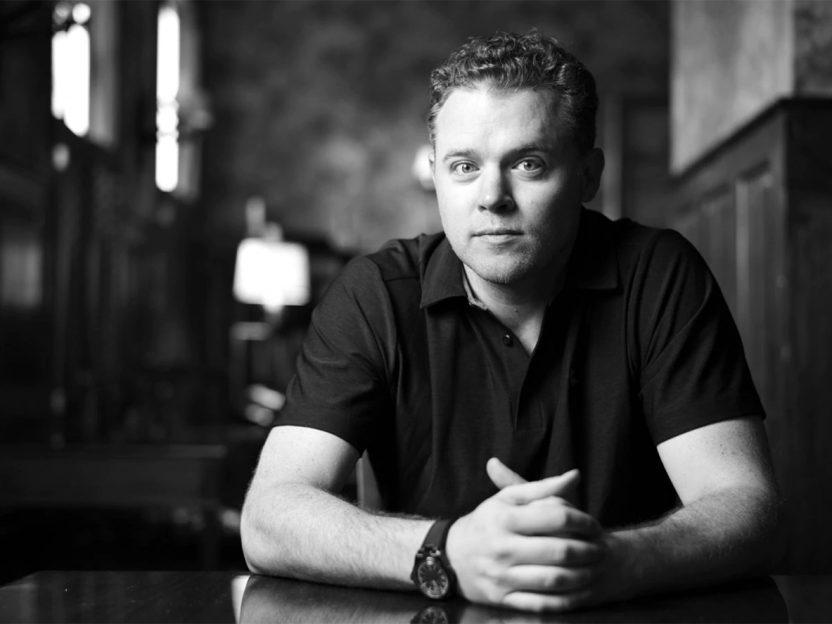Black and white photograph of Jason Hehir