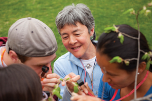 Williams biology professor Joan Edwards examines plants with her students.