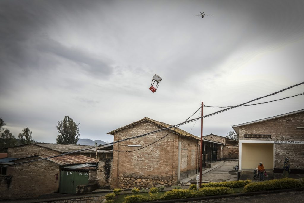 Photo of a Zipline International drone delivering blood to a village in Rwanda.