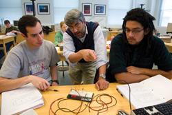 """Williams physics professor Protik """"Tiku"""" Majumder with students in his lab."""