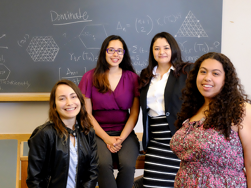 From left: Nohemi Sepulveda '18, Dalia Luque '18, assistant professor of mathematics Pamela Harris, and Claudia Reyes '18.