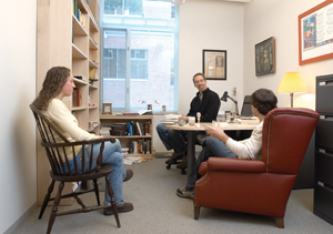 Williams English professor Peter Murphy in his office with students.