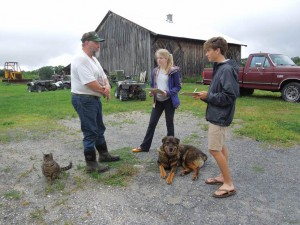 From left: farmer Neil Oleson is interviewed by students Samantha Murray, Class of 2014, and David Nolan, Class of 2013, for the Keep Berkshire Farming project.