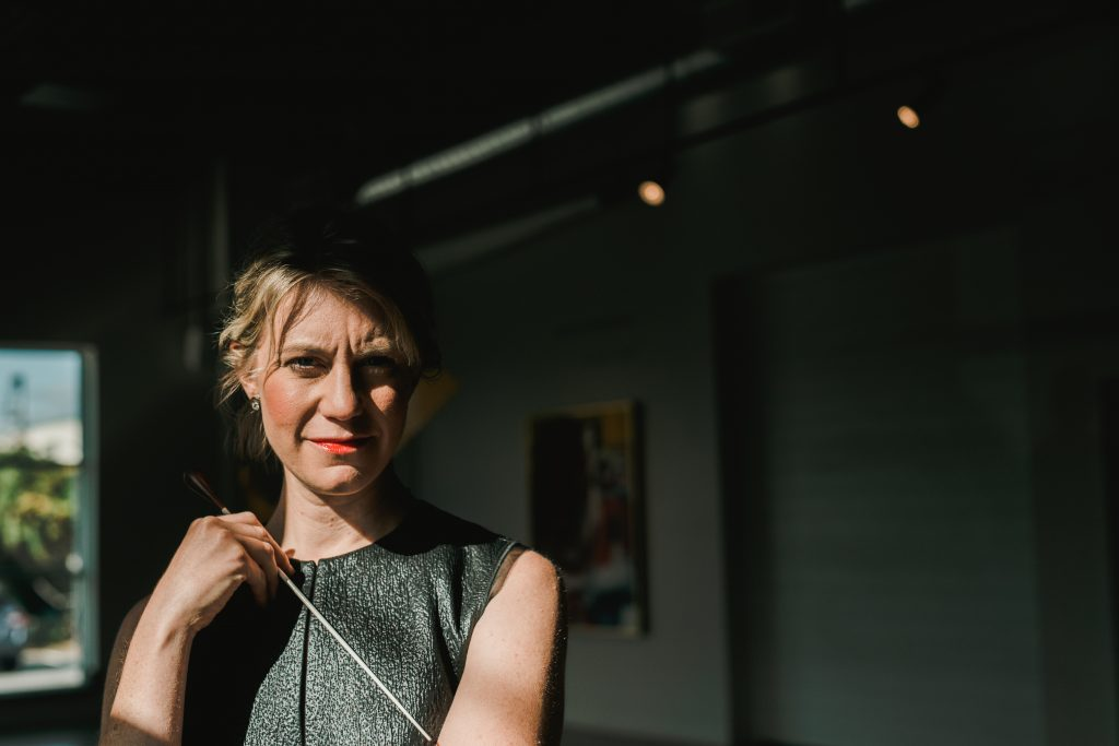 Headshot of Classical Uprising founder and conductor Emily Isaacson.