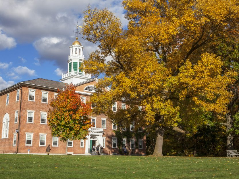 Griffin Hall with fall foliage surrounding it