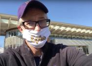 A man in a purple Williams baseball hat, glasses, and Ephs mask is seen in front of Paresky Center.