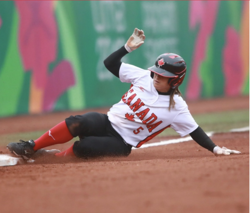 Joey Lye, Williams Class of 2009, in an official Team Canada Softball photo, slides onto a base