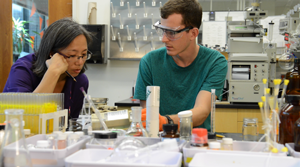 Professor Lee Park works with a student