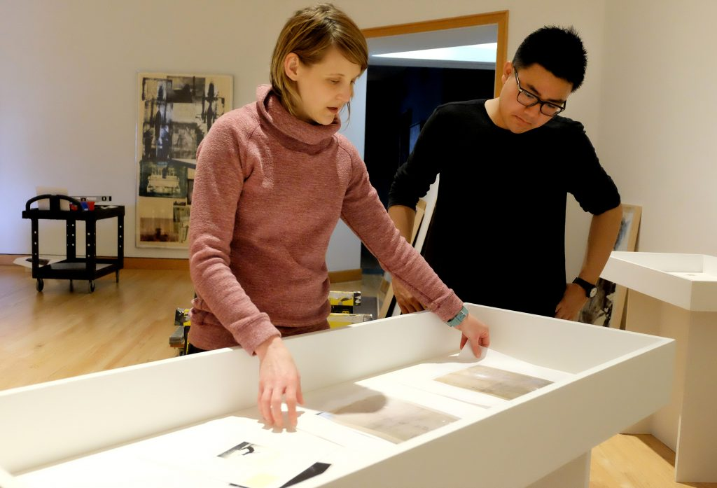 Curator Lisa Dorin and Alex Jen '19 look at materials from the course Rauschenberg: Art & Archives, which informed an exhibition that runs through Aug. 20, 2017.
