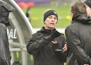 Photo of Williams College women's soccer coach Michelyne Pinard talking to her players.
