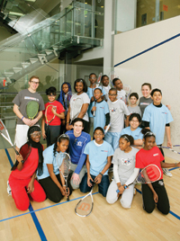 Christian Henze, Williams Class of 2010 (back row, left), Jessica Lovaas, Williams 2006 (back row, right), and Tony Maruca, Williams 2008, (front row, center), with StreetSquash students in Harlem.