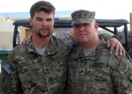 A photo shows alumnus Hank Montalbano with his arm around a colleague from the military.