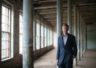 Director of MASS MoCA Joe Thompson poses in one of the museum's empty factory spaces.