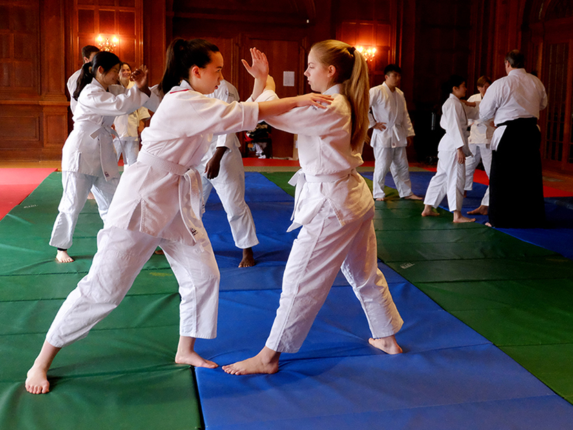 A photo of two students practicing Aikido