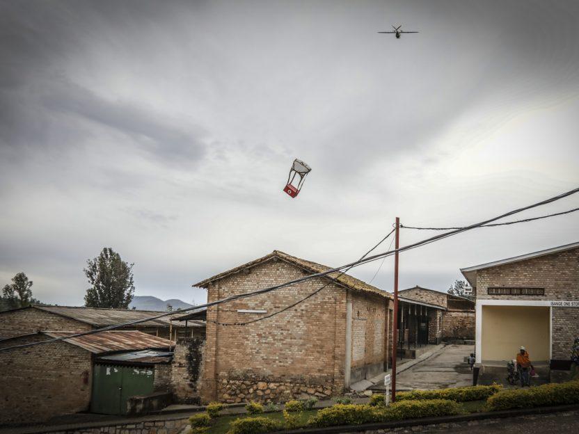 Photo of a Zipline International drone delivering blood to a village in Rwanda.