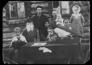 Soviet-era photograph of grandchildren, presumably from a city in the USSR, visiting village relatives, provided to the New York Times by Williams Sociology Professor Olga Shevchenko, who wrote a piece for the Sunday Review about researching Soviet-era photographs and the memories they evoke.