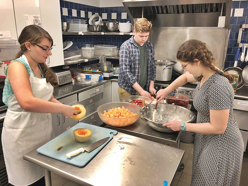 Three Williams students prepare Shabbat dinner for a meal that takes place after Friday night services.